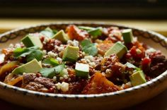 My friend made this last night and it was AMAZING. She didn't use a slow cooker - just used a dutch oven on stovetop for 2 hours - but either way I think it's a solid awesome. Rick Bayless | Slow Cooker Simplicity