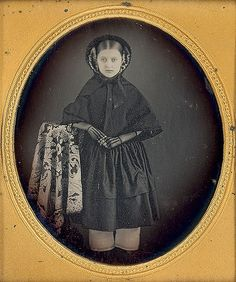 1/6 plate of a pretty young girl who looks like she is in morning. It is unique to find daguerreotype of standing full figures.