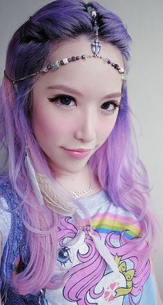 Love her purple colored hair and the hair jewelry going on