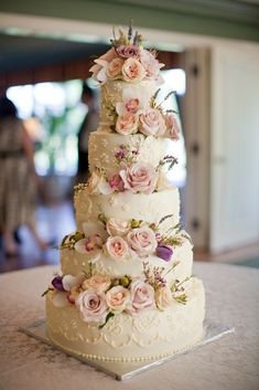 Rose Adorned Wedding Cake | Country Cupboard https://www.theknot.com/marketplace/country-cupboard-long-lake-mn-213925 | Hyacinth Events https://www.theknot.com/marketplace/hyacinth-events-saint-paul-mn-388588 | Fishtale Photography https://www.theknot.com/marketplace/fishtale-photography-st-paul-mn-252963