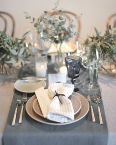 To create a cohesive feeling, this bride set her table with monochromatic centerpieces, linens, and glassware. She added a subtle bit of texture with striped napkins from Restoration Hardware.