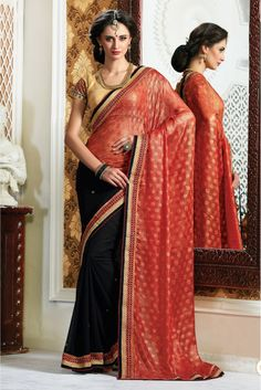Differentiate Your Look With This New and Uniquely Created Deisgner Saree. The Saree In Red and Black Color Is Crafted On Weaving Butti Chiffon Material. The Saree Is Crafted With Prints. This Saree I...