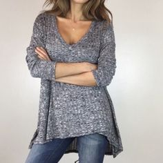 """V-Neck Tunic Grey Marbled V-Neck Tunic. NEW Completely sexy yet adorable on. So effortless, A free flowing tunic top in dark marbled grey. Features flattering V neckline and side vents. Pairs perfect with leggings. Size Med 21"""" across chest. Front length 27"""" Back length 33"""". Poly/Spandex blend. NEW NEW NEW CHIC MODERN LUX Tops"""