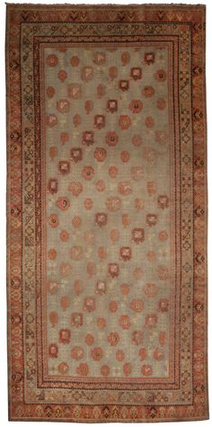 A Samarkand Rug - An Antique Samarkand Rug. Alternating diagonal rows of 3 distinctly different shapes on a nuetral field within a multi-stepped border. ...