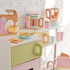 wood baking, toaster, coffee maker and blender sets to go with her KidKraft pink kitchen