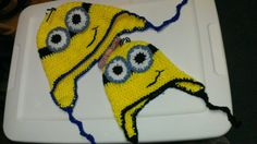 I made minion hats!  Child-size for Lilly (remove bow and it works for Charlie later!) and adult size for me!