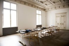 A large work table in the studio is flanked by Hans Wegner chairs (Photograph by Jil Sander)