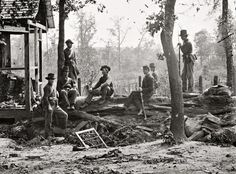 """1864. A passel of Yankees in repose. """"Federal picket post near Atlanta, Georgia."""" Wet collodion  glass plate negative by George N. Barnard"""