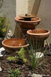 Clay Bowl Fountain For Mom's garden - easy directions to follow  hhtp://www.the-landscape-design-site.com/fountains/foutain3.html  another site good too:   home-and-garden.webshots.co...