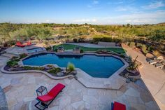 Step outside and you can't miss the resort-style backyard with an oversized newer pool and spa with water feature, fire features, flagstone deck, tiled covered patio, extended patio, professional landscaping, putting green and built-in BBQ.