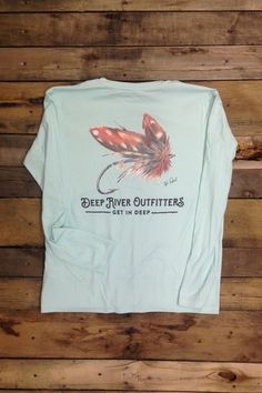 Deep River Outfitters celebrates the sport and art of fly fishing with our Tamarin Fly Long Sleeve Solar Performance tees, perfect for the river or every day featuring up to 50 UPF solar protection and moisture wicking technologies. Original art by Tyler Daniel is printed on our Seagrass 100% microfiber polyester long sleeve solar performance tee.