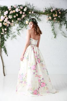 'Posey' RRP £1,650 A pretty floral crop top and skirt 2-piece featuring an on trend pocket detail sets the trend for bridal fashion.