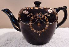 Antique English black teapot with gold garlands and blue enamel beading