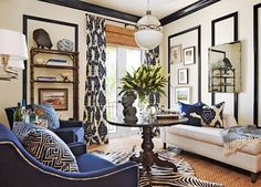 Love the layered, textured, exotic vibe in this room by Barclay Butera. Off white walls and black millwork and moulding play perfectly with navy patterned draperies and pillows, tons of grasscloth and - Modern Living Room Blue And White Curtains, Blue And White Living Room, My Living Room, Home And Living, Living Room Decor, White Walls, Blue Living Room Chairs, Blue Living Rooms, Living Room Drapes