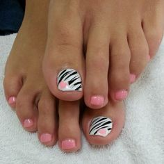 Pink nails with a white and black zebra print accent nail with a pink heart