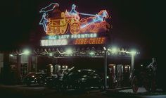 The very cool neon sign at the Texaco station by The Last Frontier Hotel 1947.