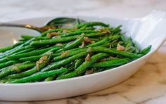 How can a vegetable recipe with only one tablespoon of oil and three simple ingredients -- olive oil, green beans and shallots -- be so delicious? It's all in the technique, which combines slowly cooking shallots in olive oil to coax out their natural sweetness and simmering beans in a bit of water until tender.