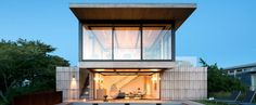 Hamptons home by Bates Masi features cantilevering upper floor   www.essentialhome.eu/blog   #midcentury #interiordesigner #hamptons