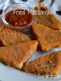 Olive Garden Fried Mozzarella. (Copykat)  Delicious crispy breading, with warm stringy cheese inside.