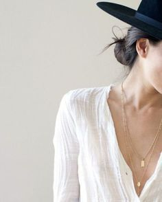 The black hat against the plunging white shirt is a great look!