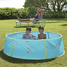 Sun Smarties Pop-Up Pool and Ball Pit: Designed by OSA!  Abracadabra: instant pool, shade, and ball pit! Our kiddy pool pops right open, ready to fill, and its UPF 50+ canopy blocks UV rays all day. Just reposition the canopy to follow the sun. Now sturdier than ever. Stay-clean cover and carry bag included (take it to Grandmas house or the beach!)...