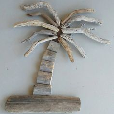 Driftwood Palm Tree, Beach Cabin Decor, Tropical Nursery Decor, Driftwood Art Beach Decor, Hawaiian Home decor, Tropical Beach Wall Hanging by Oceanwoodcreation on Etsy https://www.etsy.com/listing/537428059/driftwood-palm-tree-beach-cabin-decor