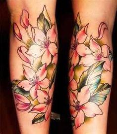 Tatuagem De Flor Perna 2011 260x300 Tatuagens Femininas Nas Pernas