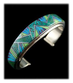 Turquoise Inlay Jewelry by high end American artists is amazing these days.  This beautiful natural Turquoise, Gaspeite and Sugilite bracelet is a good example of modern Inlay Jewelry