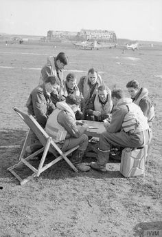 NCO pilots of No. 249 Squadron RAF enjoy an open-air game of cards between sorties at Grottaglie, Italy,