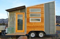 A 120 sq.ft. lightweight, aerodynamic tiny house that's easy to tow and built with reclaimed materials. Prices start at $34,000 for a 16' trailer.