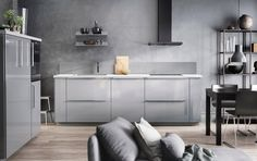 Grey kitchen design with grey walls
