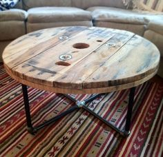 DIY IDEA >>> Round reclaimed / salvaged wood spool table with steel pipe base. Great rustic / industrial style piece - Keith can make? Pipe Furniture, Furniture Projects, Furniture Design, Furniture Decor, Building Furniture, Furniture Removal, Office Furniture, Furniture Stores, Cheap Furniture