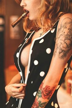 Most of us will agree that there is a particular allure of a woman smoking a cigar! Women smoking cigars might be a less common sight than men. Cigars And Women, Women Smoking Cigars, Cigar Smoking, Girl Smoking, Cigars And Whiskey, Good Cigars, Cuban Cigars, Whisky, Sexy Tattoos