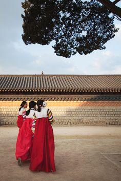 girls wearing Hanboks, or the traditional Korean dress, visiting the royal palace (Gyeongbokgung) during new year's day.    Seoul, Korea