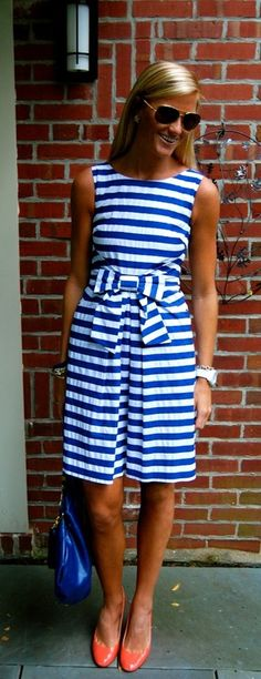 HORIZONTAL LINE: This blue striped dress is very summery. The stripes makes her wider and stocky looking. I would not recommend someone wearing a dress like this one. It's very casual and beach like. I would never wear this dress!