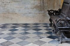Antique black and white stone tile villa flooring ~ perfection with that iron bench! Decor, Tiles, Stone Flooring, Grey, White Stone, Flooring, French Style Interior, Distressed Walls, White Stone Tiles