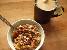 #breakfast oatmeal with apple, cinnamon, molasses, flax, sunflower seeds, and soy milk, twinnings earl grey tea with sugar and soy milk