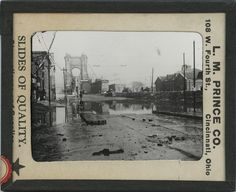 Covington, Kentucky, 1937 flood, from the Lantern Slide Collection of the Public Library of Cincinnati and Hamilton County: Covington end of Roebling Suspension Bridge.