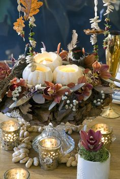 If you'd like to try your hand at a holiday DIY, scoop out a few baby pumpkins to create pretty candle holders, and your guests will be calling you Hostess with the Mostess.