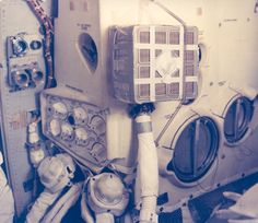 "An interior view of the Apollo 13 Lunar Module and the ""mailbox."" The ""mailbox"" was a jerry-rigged arrangement which the Apollo 13 astronauts built to use the Command Module lithium hydroxide canisters to purge carbon dioxide from the Lunar Module. Lithium hydroxide is used to scrub CO2 from the spacecraft atmosphere. 4-17-1970"