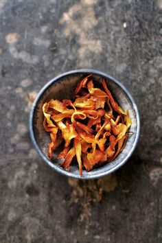 Crispy Parsnip Ribbons -  baked, not fried! These are great as a snack or topping for soup, salads, casseroles, etc. Super easy to prepare. - Twigg studios