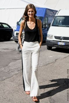 black top and white pants