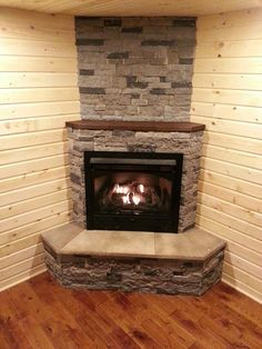 Our final product. We replaced the wood burning stove with a gas zero clearance fireplace. The stained recessed mantle makes it really pop.