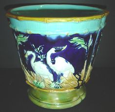 """ANTIQUE ENGLISH MAJOLICA JARDINIERE --unmarked_  DECORATED WITH STORKS IN MARSH_    probably --JOSEPH HOLDCROFT MAJOLICA C 1870_    STRONG COLORS -- 10"""" TALL X 10.5"""" WIDE"""