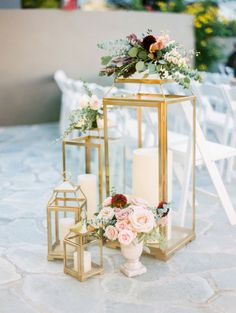 Gold lanterns with flowers and candles for the wedding isle. Lantern Centerpiece Wedding, Wedding Lanterns, Wedding Ceremony Decorations, Wedding Centerpieces, Wedding Table, Wedding Ideas, Wedding Receptions, Centerpiece Ideas, Wedding Trends