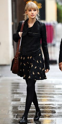 cat print skirt that she paired with oversize studs, a motorcycle jacket, brown satchel and lace-up brogues.
