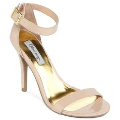 Wedding shoes!! Take your wardrobe to new heights with these tall, patent heels featuring a buckle ankle strap.