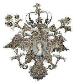 ESCUELA ESPAÑOLA, PP. SIGLO XIX Retrato de dama en una medalla devocional con águila bicéfala coronada y tembladeras