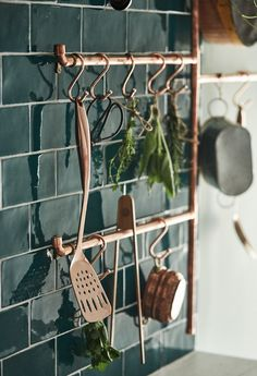 Make a beautiful bespoke rack to hang kitchen utensils off from copper pipe off cuts. Get kitchen ideas inspiration from Howdens.
