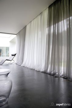 The New York City Collection is a textured and striped metallic sheer in tonal white, ivory, taupe, gold, copper, grey and black. This collection has been zinc banded and is ideal for curtains and accessories.